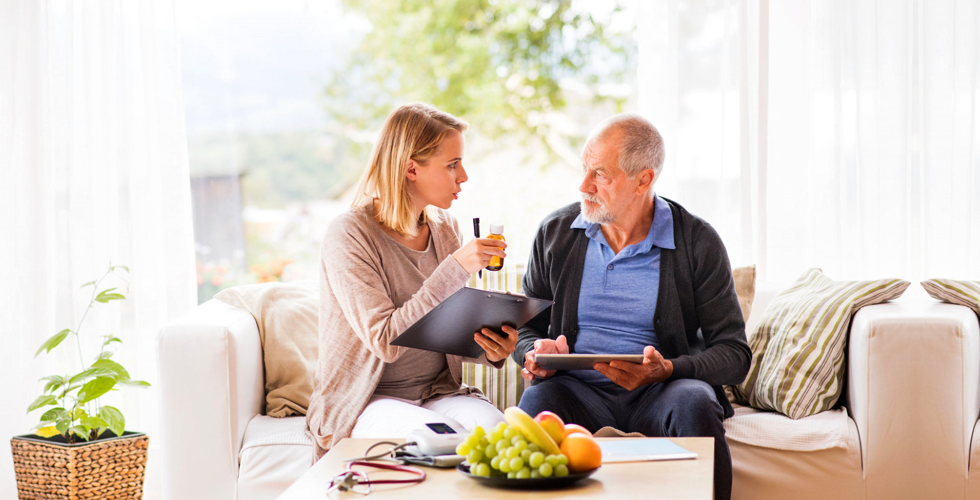 caregiver and elderly man are talking
