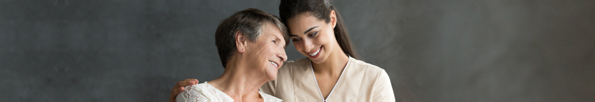 senior woman with female caregiver smiling