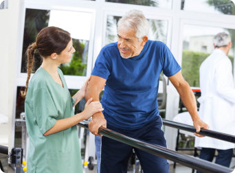 caregiver and elderly man having their physical activities